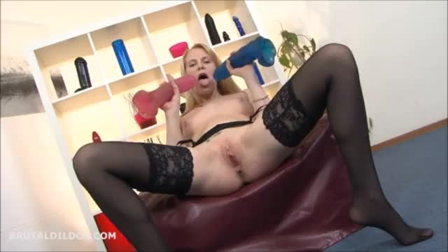 Strawberry blonde beauty fucked by two big brutal dildos